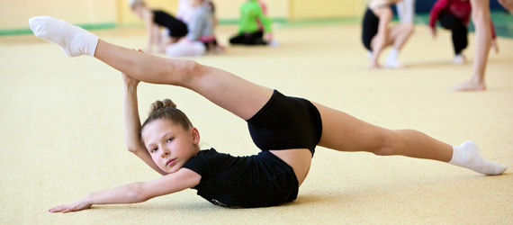 young girl stretching in ballet class