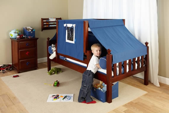 young boy with maxtrix toddler bed and play tent