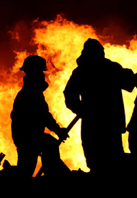 firemen fighting burning building