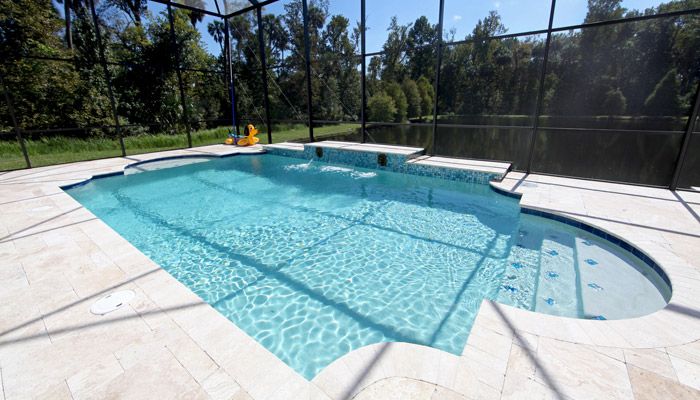Pros & Cons of Concrete or Gunite Swimming Pools