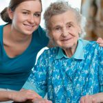 young woman assisting elderly lady
