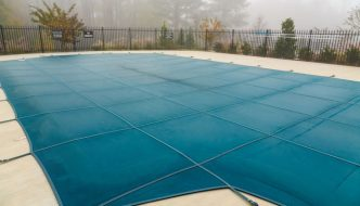 durable swimming pool cover securely attached