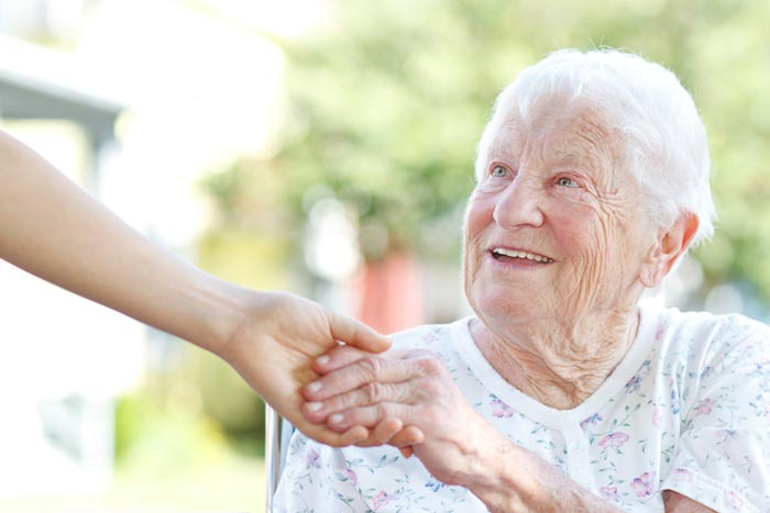 friendly hand out to hold elderly lady's hand