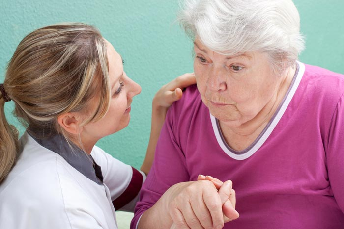 home care assistant helping elderly lady