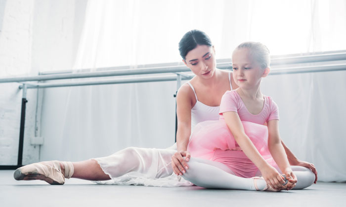 dance instructor reassuring young ballet student