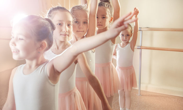 happy group of young ballerina girls