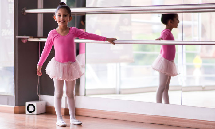 little ballet girl in dance class with smile