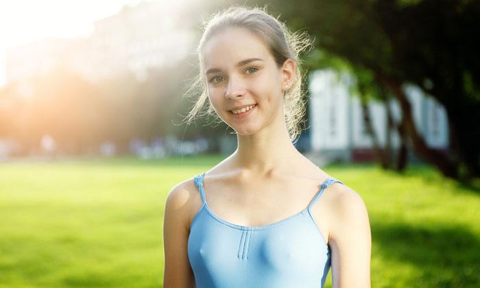 smiling ballerina girl in hazy sunlight