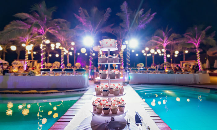 wedding cake by swimming pool