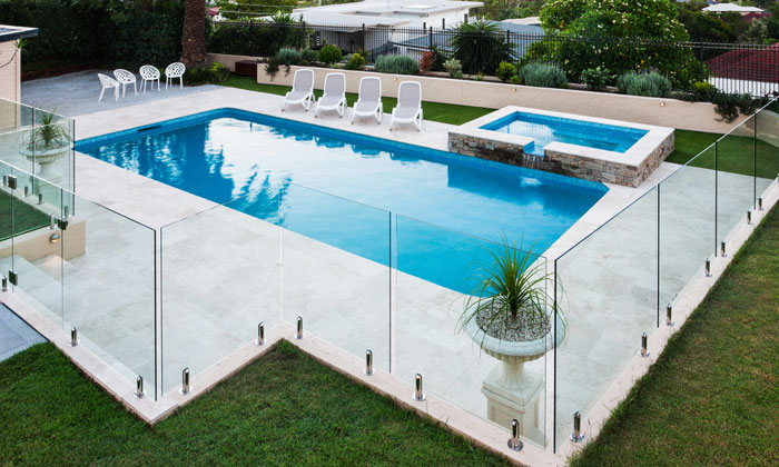 glass tall fence around swimming pool area