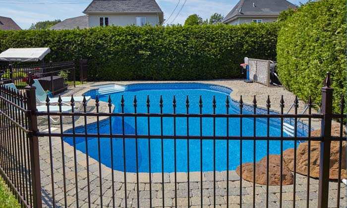metal fence protecting family pool area