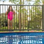 swimming pool fence blocking little girl access