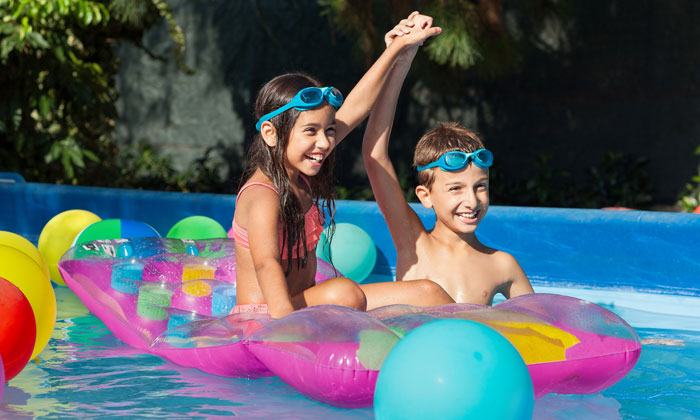 boy and girl playing in pool