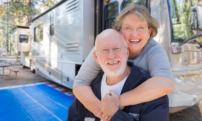retired elderly couple by camper