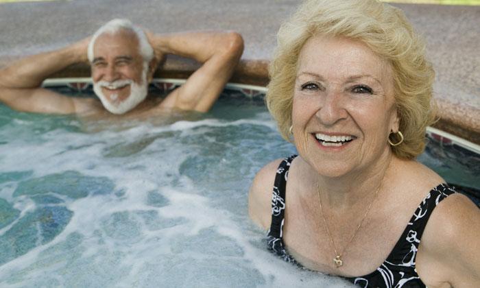 elderly-couple-enjoying soothing water in hot tub