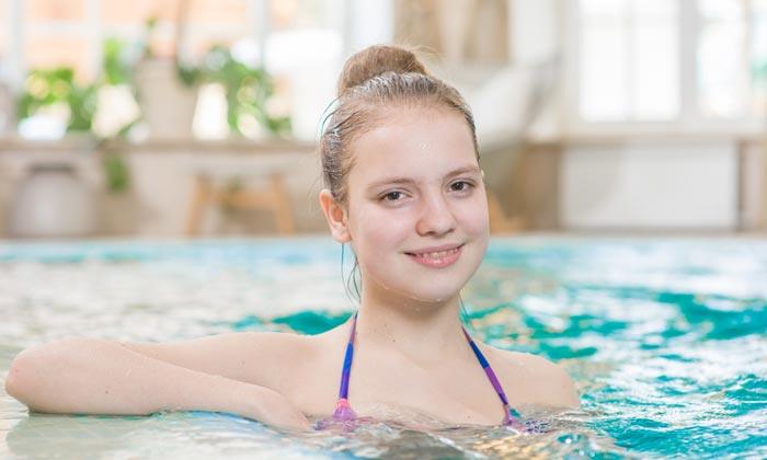 smiling teen girl enjoying pool water
