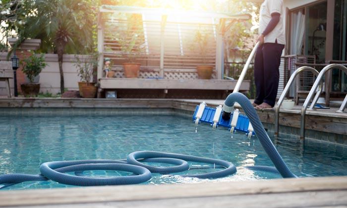vacuuming storm debris from swimming pool