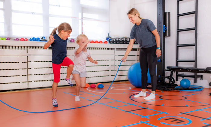 instructor teaching how to jump rope