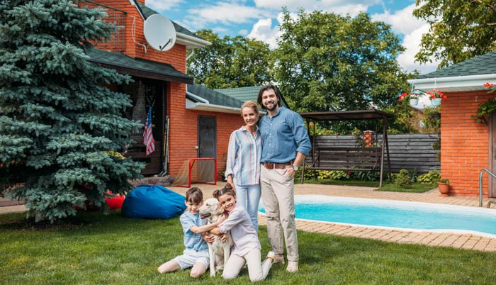 happy family with dog house pool and trees