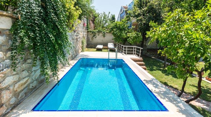 long rectangular pool hidden in small backyard